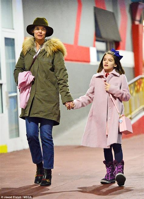 Katie Holmes holds hands with daughter Suri walking in NYC ...