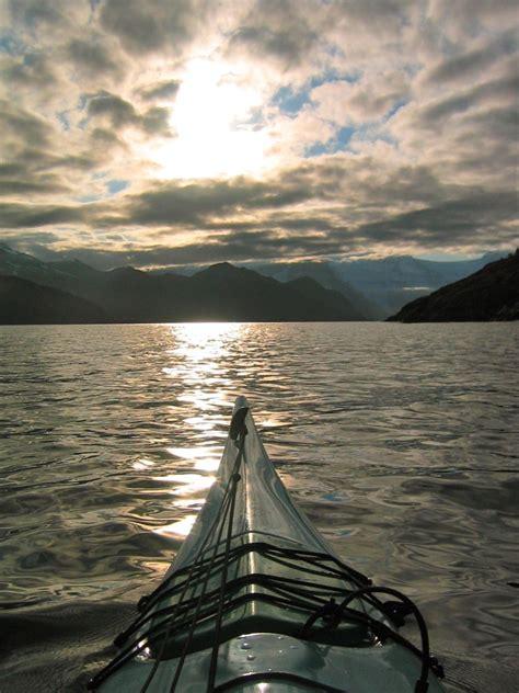 Kayaking in the fjords of the Kenai peninsula in Alaska ...