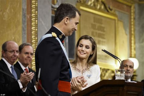King Felipe of Spain kisses new Queen Letizia as he takes ...