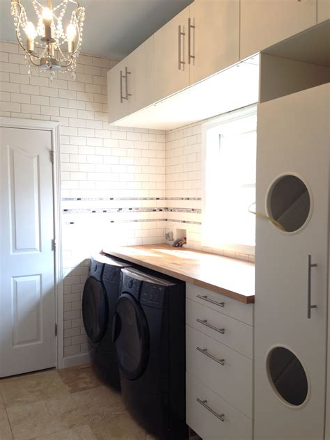 Laundry room with Ikea Akumum cabinets and Applad doors ...