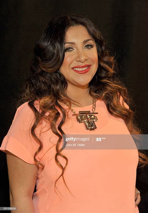 Martha Lopez Vargas poses for pictures at the Getty Images ...