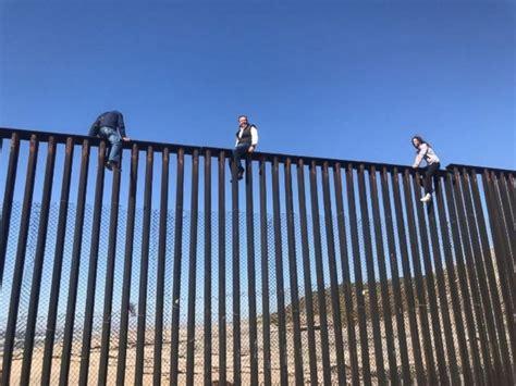 Mexican congressman climbs U.S. border fence to illustrate ...