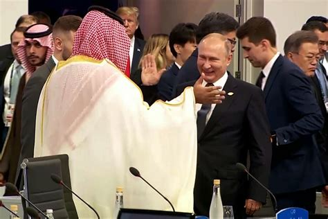 Moment Vladimir Putin and Saudi crown prince high five in ...