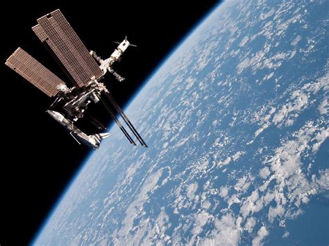 NASA Releases Spectacular Portrait Photos of Endeavour ...