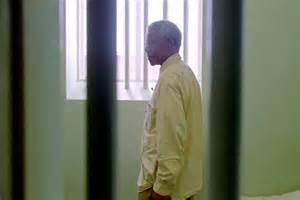 Nelson Mandela stands in the prison cell he occupied on ...
