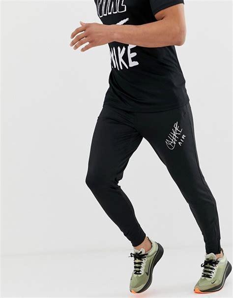 Nike Running swoosh print tapered joggers in black | ASOS