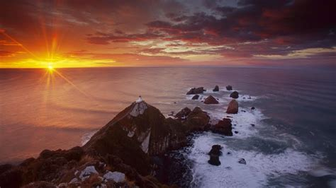 Nugget Point Lighthouse At Sunrise, South Island, New ...