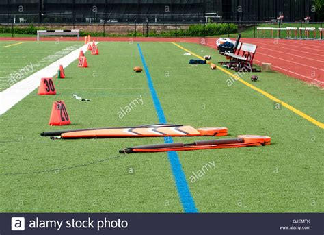 Orange field markers on football field Stock Photo ...