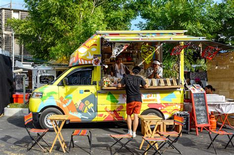 People Order Meal From Food Trucks At Food Truck Fair In ...