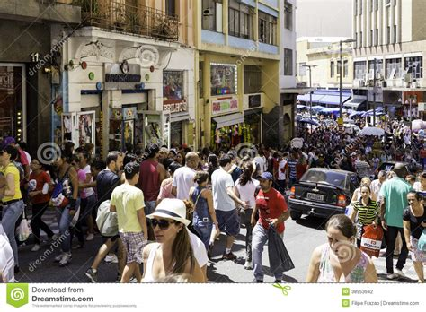 People Walk Along The 25 March, Sao Paulo Editorial ...