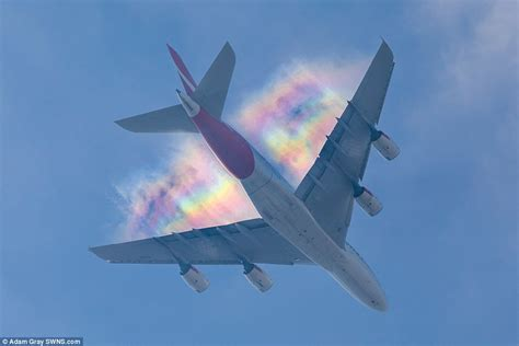 Photos capture  rainbow contrails  at Heathrow Airport ...