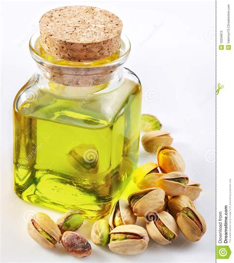 Pistachio oil with nuts stock image. Image of color, white ...