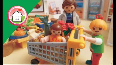 Playmobil Portugues Comprando com a familia Hauser A ...