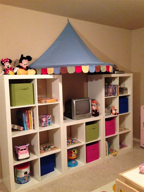 Playroom shelving. Expedit shelves and awning from Ikea ...