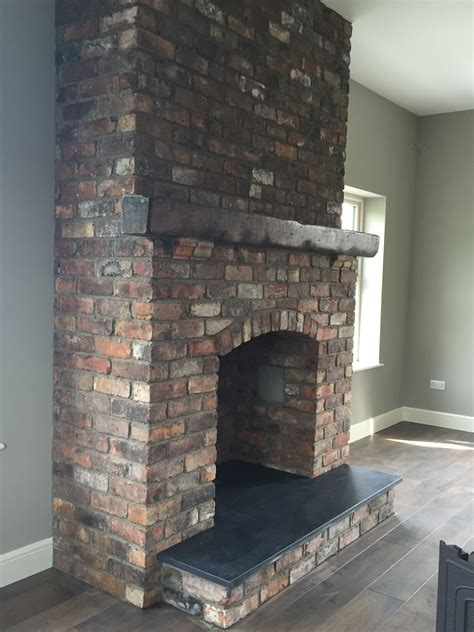 Reclaimed brick feature fireplace with Kilkenny limestone ...