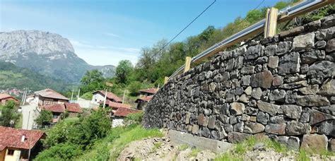 Reconstruido el muro que amenazaba la integridad de varias ...