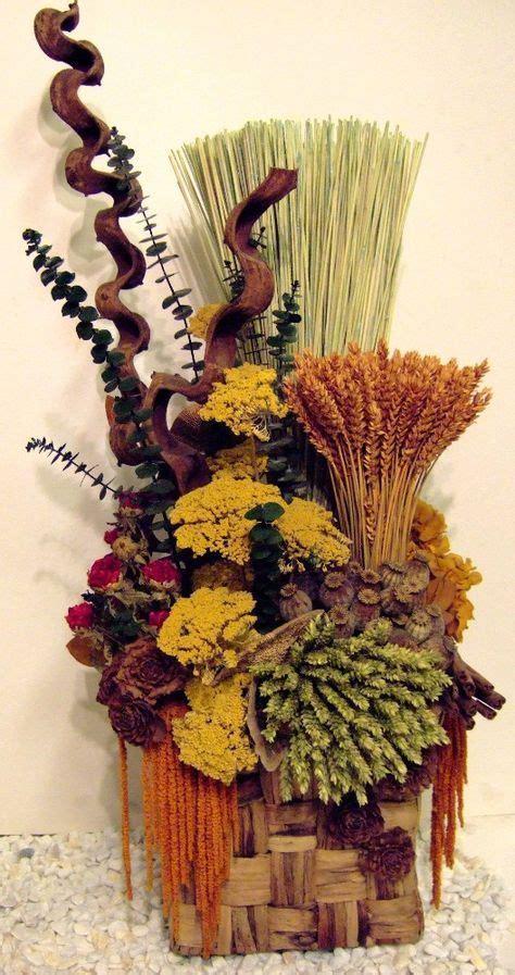 Resultat d imatges de centro de mesas con flores secas ...