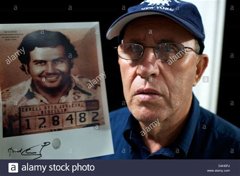 Roberto Escobar with a picture of his brother Pablo ...