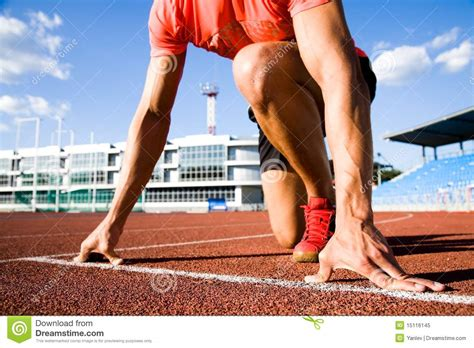 Runner at the start stock image. Image of crouching ...