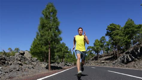 Running Man   Male Runner Jogging Outdoors On Road ...