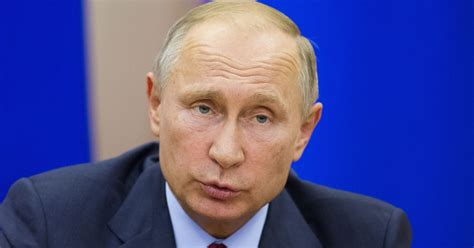 Russian President Vladimir Putin giggles at minister s ...