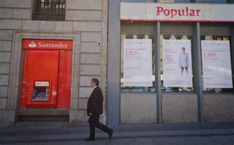S&P rebaja la perspectiva del rating de Santander tras la ...