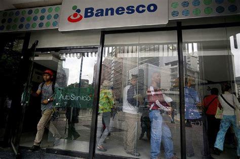 Seized Venezuela bank s clients line up