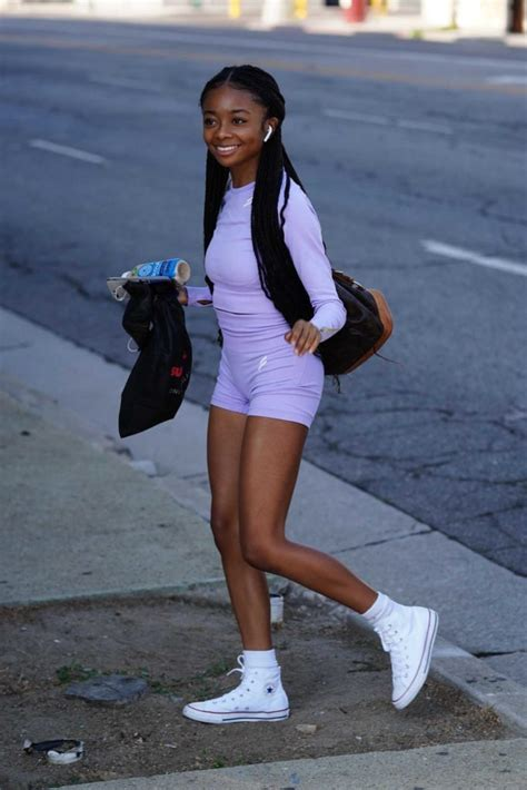Skai Jackson in a Purple Workout Ensemble Arrives at the ...