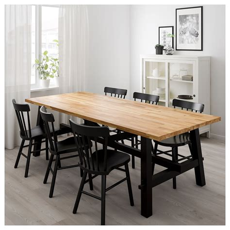 SKOGSTA/NORRARYD dining table and chairs acacia/black ...