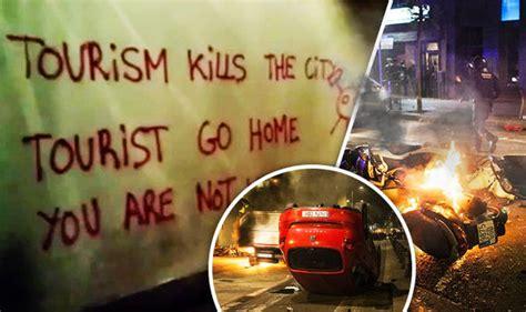 Spain's anti tourism riots   violent clans MERGE to target ...
