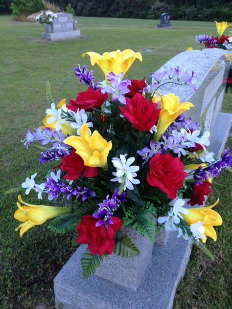 Spring/Summer cemetery vase using yellow lilies, red roses ...
