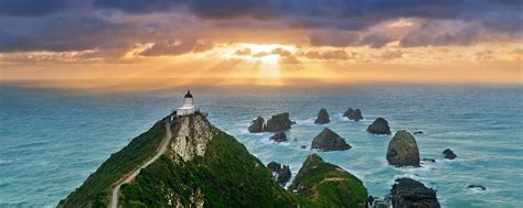 Sunrise at Nugget Point New Zealand | Nugget Point, New ...
