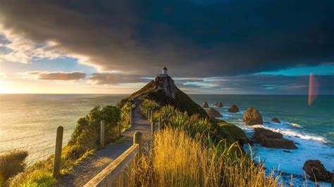 Sunrise Time Lapse at Nugget Point Lighthouse, New Zealand ...