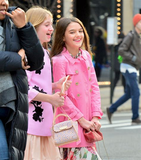 Suri Cruise, 12, steps out in a $900 Burberry coat, more ...