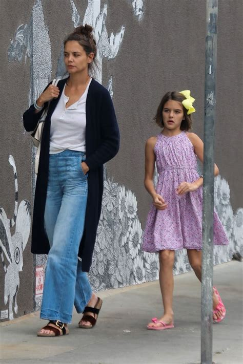 Suri Cruise is all grown up as she joins mum Katie Holmes ...