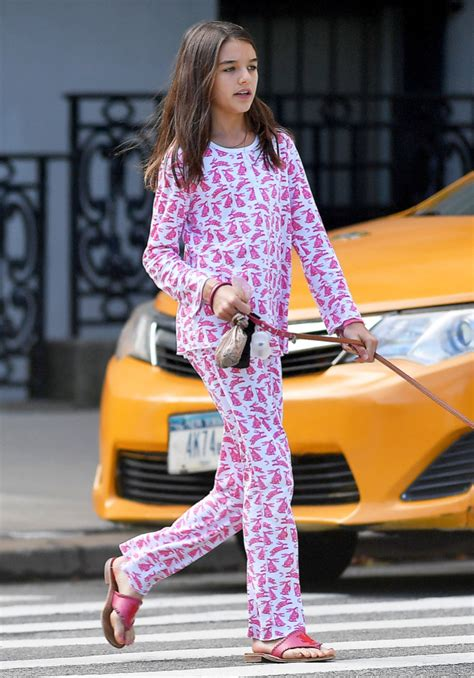 Suri Cruise Looks Grown Up as She Takes Dog Out for a Walk ...