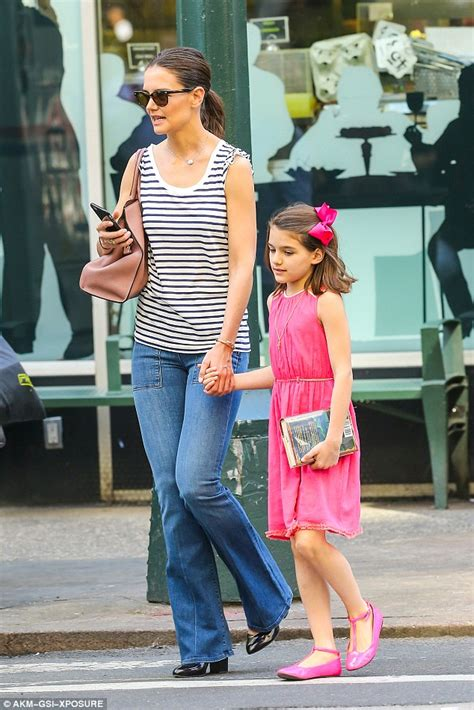 Suri Cruise sticks tongue out after claims she has not ...
