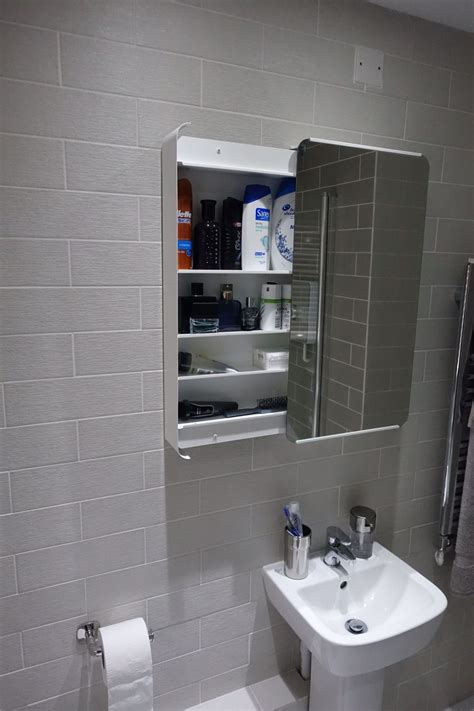 The bathroom cabinet was purchased from ikea  Brickan ...
