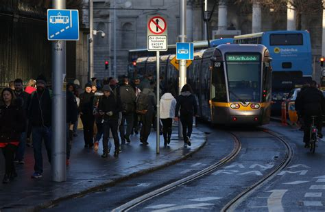 The Luas goes at a  slow jogging pace  through Dublin city