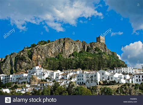 The White Town of Zahara de la Sierra at the foot of a ...
