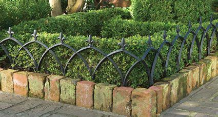 This aluminum garden fence adds a decorative touch to ...