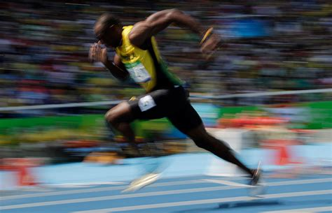 Usain Bolt's mid race smile celebrated by meme makers ...