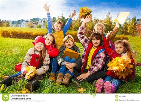 Very Happy Kids On The Lawn Stock Photo   Image of casual ...