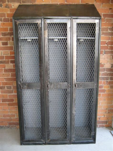 vintage metal lockers. would be awesome for a coat closet ...