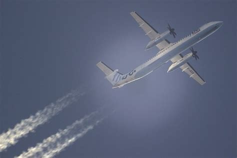 What causes a jet aircraft contrail, and why do we see ...