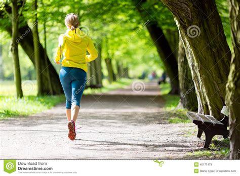 Woman Runner Running Jogging In Summer Park Stock Photo ...