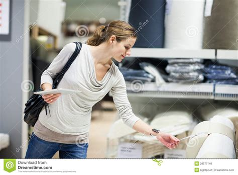 Young Woman Shopping For Furniture In A Furniture Store ...